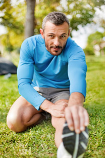 istockphoto_14797436-man-stretching-before-exercise.jpg